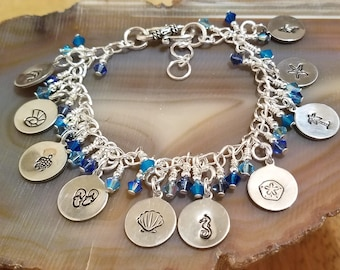 Blue Beach Swarovski crystal bracelet featuring ten hand stamped charms chock full of summer fun and it's adjustable too!