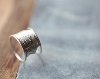 Folium ring. Sterling silver wide band. Roller Printed Jewelry