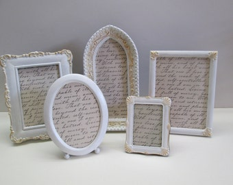 Collection of assorted shape white painted frames for family photos, shabby decor, weddings