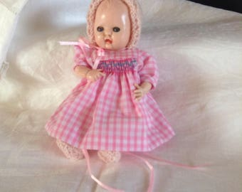 Vintage 1950's Rosebud doll and new clothes