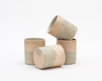 Pink and speckled ceramic beaker cup. Ceramic beaker glass. Beakers. Speckled pottery. Modern ceramics. Contemporary ceramics. Pink cup mug