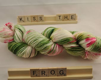 "Hand-dyed yarn, ""Kiss The Frog"" speckled, variegated, soft and squishy yarn. Great for socks or shawls. 80/20 Superwash wool/Nylon"