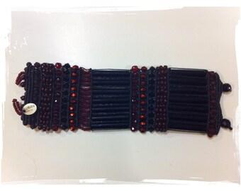 Its striking Swarovski black wrist band cuff, ROSAMUNDA-Garnet and bourdeaux-new
