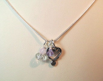 Charm necklace, heart shaped charm  with crystals and glass bead