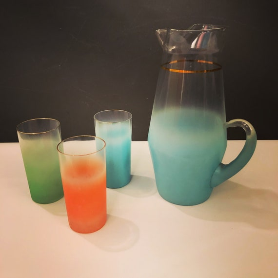 Mid-Century Set of 3 Highball Glasses & Pitcher with beautiful orange, blue and green colors. Each has a gold trim.  Made by West Virginia