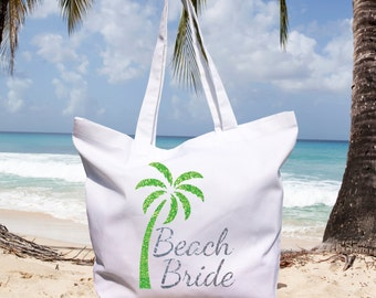 Beach bride white 100% organic cotton bag with glitter writing and green glitter palm tree. Very sparkling!