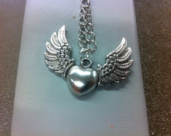 Silver toned winged heart necklace