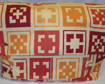 Heather Baby Bag in Red, Gold, Orange Block Print Cotton and a cream canvas lining
