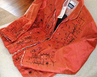 YAK MAGIK JACKET.. Nepal.. Silk.. Tabasco (Orange) Color.Lined in Blk. Silk.Geometric Shapes.Sequins, MirrorCircles, Ribbon on Front & Cuffs
