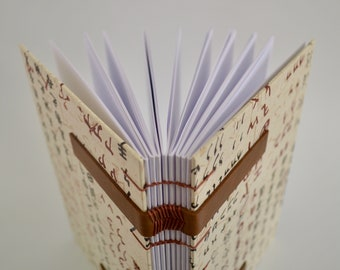 Handmade notebook with calligraphy of Japan - Handmade journal with leather bands - Coptic stitch journal - Sketchbook