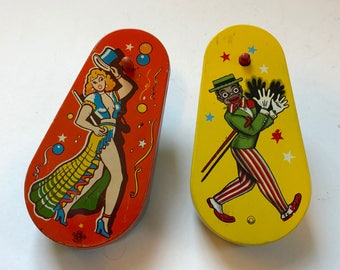 Two tin litho noisemakers