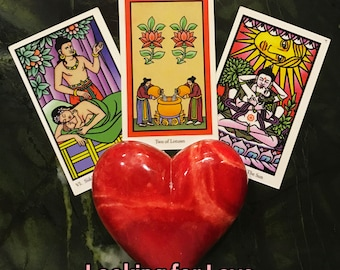 Looking for Love Spread - A three card Buddha Tarot reading to find out more about a crush, love interest, or potential new romance