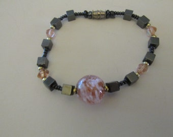 Handmade Beaded Bracelet Black, Gold Tone, and Pink