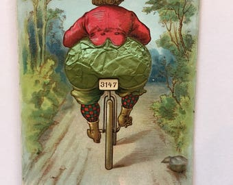 vintage novelty postcard with woman on bicycle and paper expandable butt