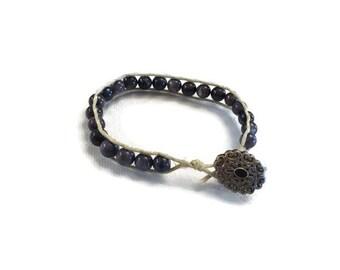 Black shell wrap bracelet button