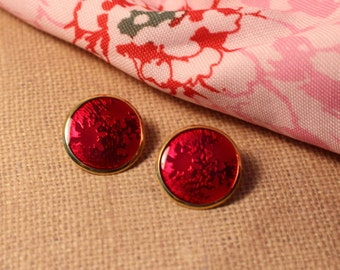 Shiny Round Red Pierced Earrings with Snow Flake Design
