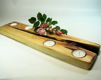 Long juniper wood tea light candle holder. Rustic juniper wood tea light candle holder.