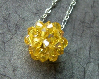 Swarovski CRYSTAL SUN BALL necklace in Light Topaz