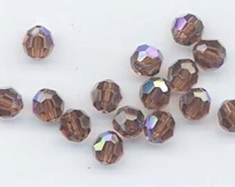 24 gorgeous Swarovski crystals - art 5000 - 6 mm - smoked topaz AB