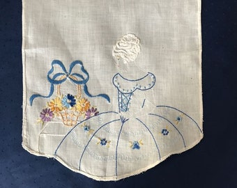 Antique hand embroidered linen bureau scarf with fancy lady and her posy basket