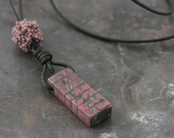 Polymer clay over wood/beaded bead necklace.