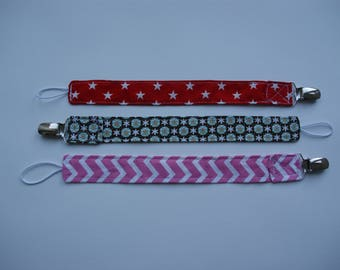 Pacifier clip in different colors for boys and girls, babyshower gift