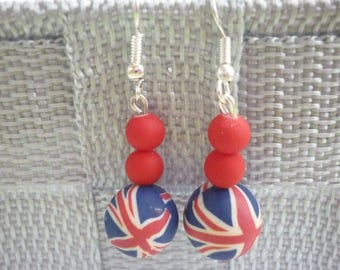 London duo of red beads themed polymer clay earrings.