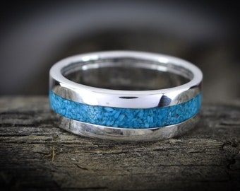 Sterling silver ring with a continuous loop of crushed Turquoise