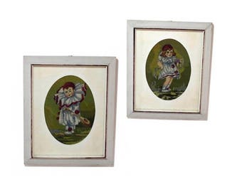 Two vintage clowns cross stitch embroidery in gray frames