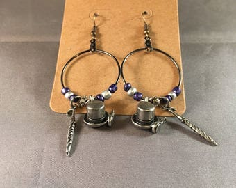 Penguin Dangle Hoop Earrings: featuring purple and silver seed beads and silver Penguin Derby Hat and Umbrella charms