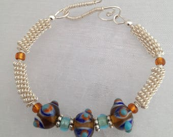Silver wirework bracelet, with Amber coloured glass lampwork beads.
