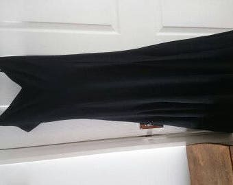 Designer Fashion. Long black strap dress -flared full skirt.