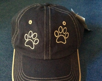 Low profile, unstructured, paw print baseball cap