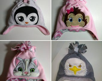 Fleece hat with ear flaps and embroidered peeker. Child size.