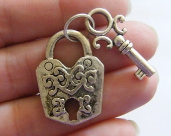 1 Lock and key pendant ( double sided ) antique silver tone