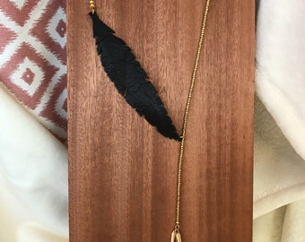 Beaded lariat style necklace with leather feather