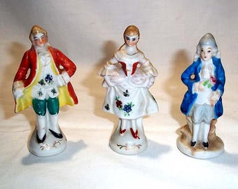 Three Hand Painted Porcelain Made in Japan Figurines - One Occupied Japan and a Pair of Colonial Man and Woman Marked JAPAN