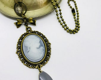Necklace cameo and bronze with charm and bow. FREE shipping