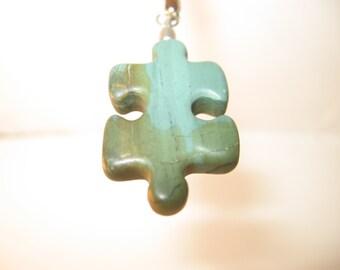 SOLD- RA62 Autism Awareness Puzzle Piece Rock Pendant