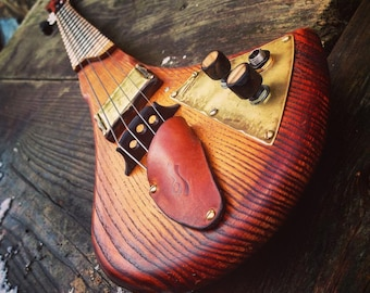 Electric fretted cello. 4-string cellotar by DaShtick guitars