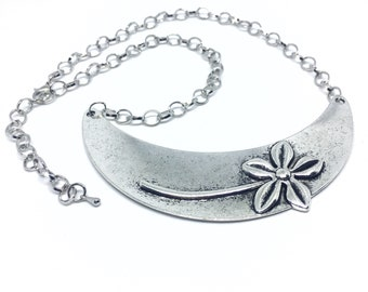 Silver Flower bib necklace.