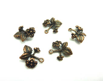 Five charms on wire copper colored 16 * 15 * 4 mm