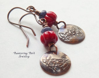 Red Lampwork Glass Bead Earrings, Sapphire Blue Gemstone, and Copper Disc with Swirling Leaves, Stamped Metal Leaf Earrings