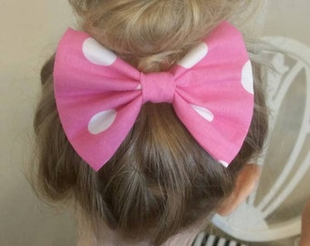 Pink and white Minnie Mouse inspired bow