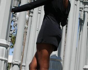 Elegant black cowl back long sleeve dress.