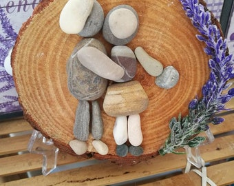 Sweethearts made with stones on a wood-based sea stone