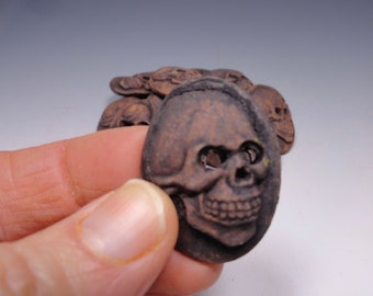 Skull buttons.  Set of 2.  Handmade stoneware. Red stoneware clay with a black oxide wash