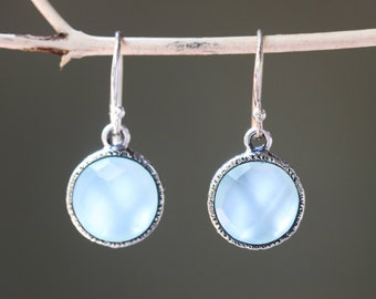 Round faceted Blue chalcedony earrings in silver bezel setting on sterling silver hooks style