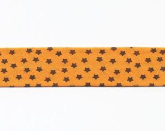 Orange stars bias Black 100% cotton by the yard