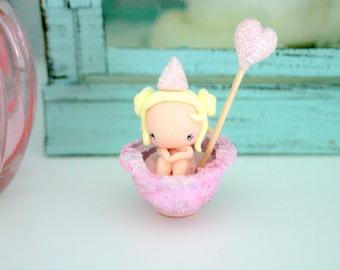 Fairy Figurine in a boat